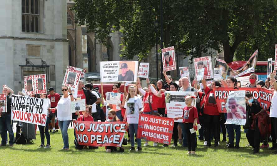 Friends and family of people convicted of murder under the law of joint enterprise protest at Parliament Square