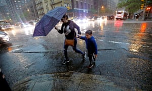 New Yorkers brave the severe thunderstorms that hit the city among tornado warnings in May 2018.