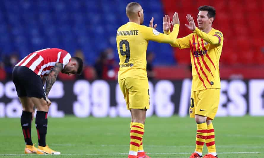 Braithwaite celebrates with Lionel Messi after winning the 2021 Copa del Rey final against Athletic Bilbao in Seville in mid-April.