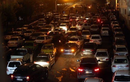 Drivers switch off engines to block main streets of Tehran during a demonstration against a government decision to hike petrol prices, in Tehran.