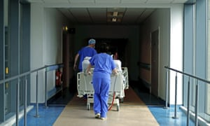 Medical staff transfer a patient through a corridor at the Royal Blackburn teaching hospital