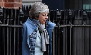 Theresa May leaving from the rear of 10 Downing Street.