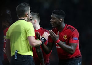 Paul Pogba talks to referee Daniele Orsato after being sent off.