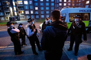 Female police officers and special constables talk to a suspect in London, England, following a stop and search in Southwark during an all-female operation by the Metropolitan police, the first of its kind for the force, to commemorate International Women's Day