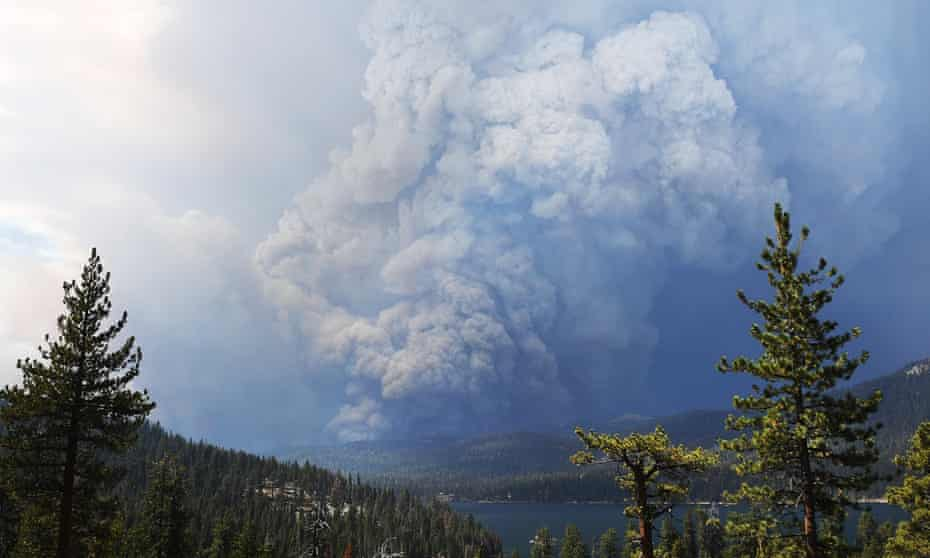 Plumes of smoke rise into the sky as a wildfire burns on the hills near Shaver Lake.