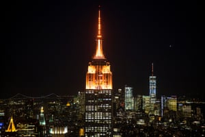 The spire of New York's Empire State Building is lit up in Amazon orange.