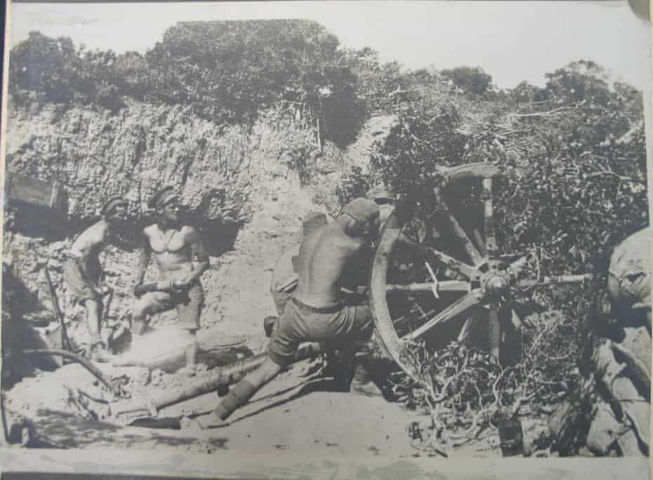 """A 9th Battery 18-pound field gun in action during a Turkish attack in WWI. The photo was reproduced in the Illustrated War News (London) on 29 September 1915 with the following caption: 'With the colonial """"Naked Army"""" in Gallipoli: Australian gunners stripped for the fray during a fierce artillery duel …'"""