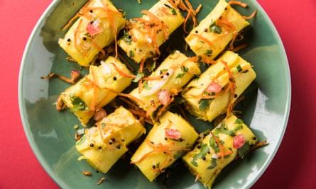 Khandvi, pillowy pasta-like rolls made with gram flour and yoghurt.