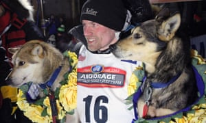 Dallas Seavey poses with his lead dogs Reef, left, and Tide after winning the Iditarod race