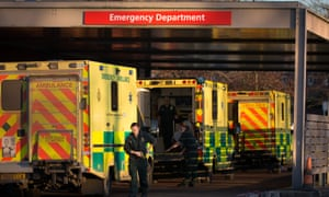 A patient is taken from an ambulance parked outside Gloucestershire Royal Hospital