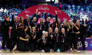 New Zealand players celebrate on the podium after winning the Netball World Cup.