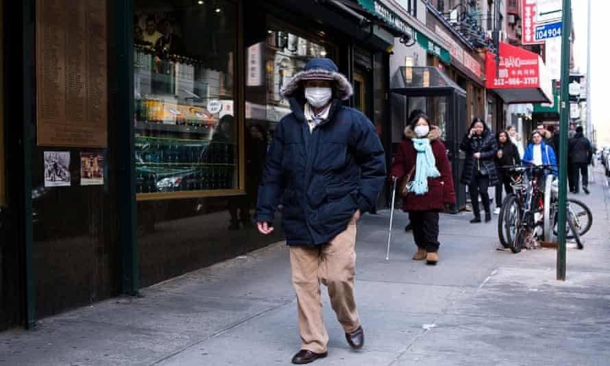 People wearing masks in New York on Friday.