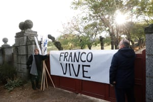 Supporters hold a banner that reads 'Franco lives' at the entrance to the Valley of the Fallen