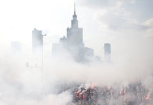 WaPeople light flares as they observe a minute's silence to mark the 75th anniversary of the Warsaw Uprising against the Nazi occupiers of the Polish capital during the second world war.