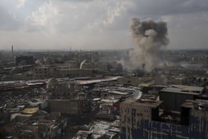A rocket explodes near Mosul's Old City during fighting against Islamic State
