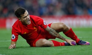 Philippe Coutinho reacts after sustaining his injury.