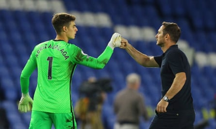 Frank Lampard celebrates with the goalkeeper Kepa Arrizabalaga after the final whistle at the Amex Stadium.