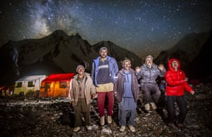 The porters photographed outside at base camp. They sometimes light fires using rubbish from the expeditions