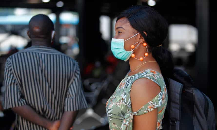 A woman queues to enter a shop in Lagos, the city at the centre of the coronavirus outbreak in Nigeria.