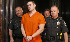 Daniel Holtzclaw is led from a courtroom in Oklahoma City last month.
