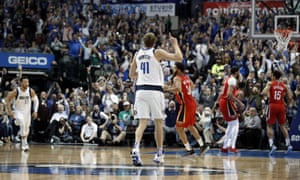 Dirk Nowitzki celebrates after sinking the basket that put him sixth on the NBA's all-time scoring list