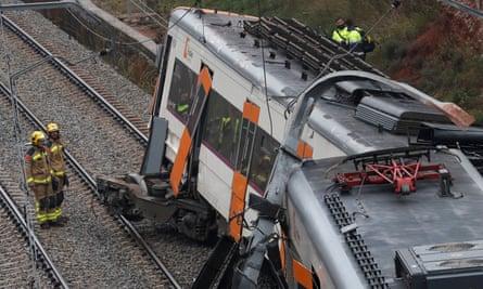 Rescue workers at the scene of a train derailment in Catalonia
