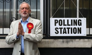 Opposition Labour party leader Jeremy Corbyn poses at a polling station