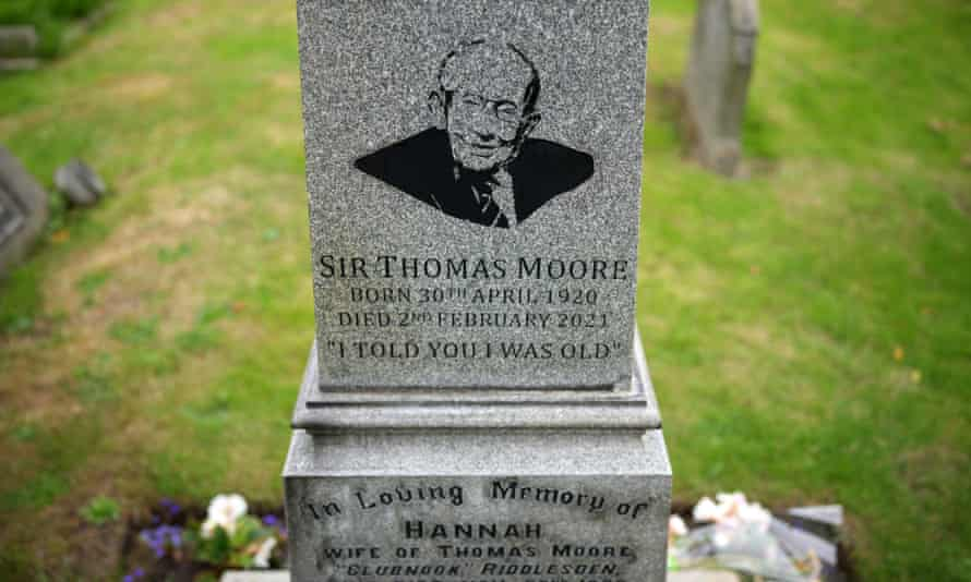 A portrait of Sir Tom Moore on the headstone of the family grave at Morton cemetery in Keighley, England.
