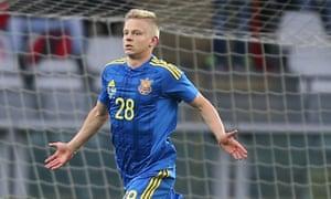 Ukraine's Oleksandr Zinchenko celebrates after scoring during a friendly against Romania