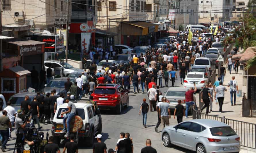 Crowds in Jenin for the funeral of two of those killed in the Israeli raid