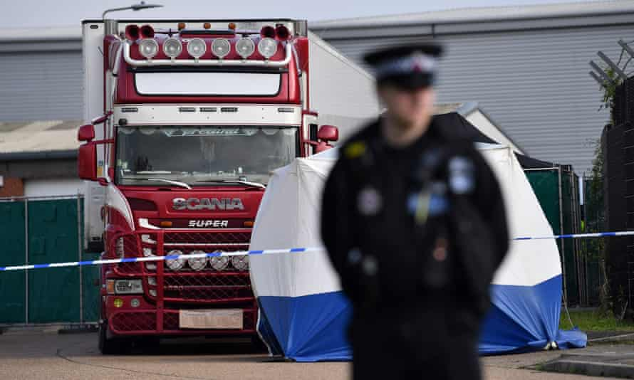 A police officer in front of a lorry in which 39 bodies were found in Grays, England