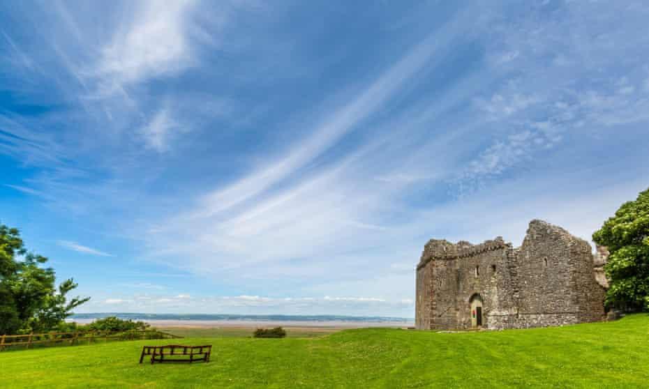 Weobley Castle with saltmarsh beyond.