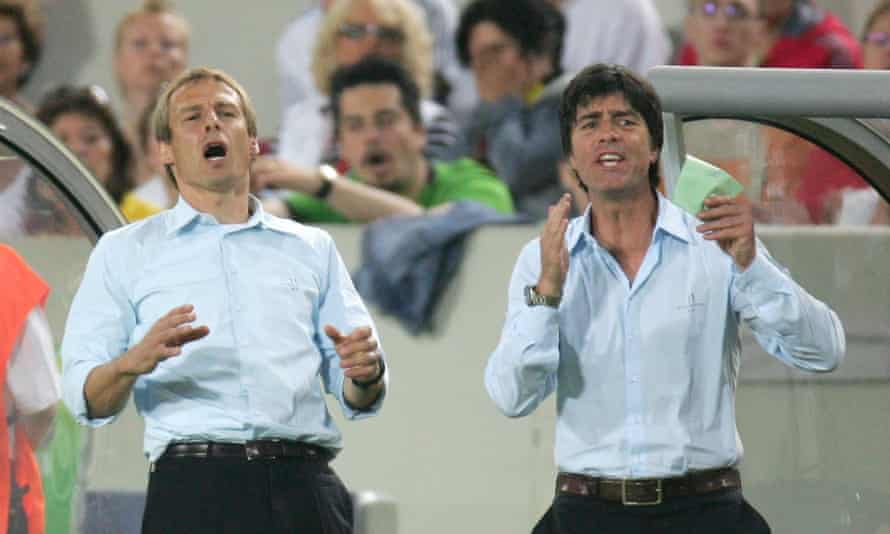 Jürgen Klinsmann and his then assistant Joachim Löw react during Germany's third-place play-off against Portugal at the 2006 World Cup.