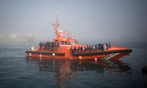 Migrants arrive on board a Spanish maritime rescue boat at the port of Tarifa
