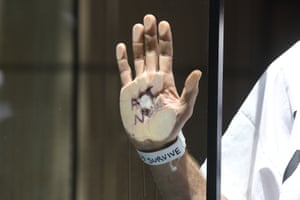 Melbourne, Australia. An Extinction Rebellion protester's hand is glued to a window