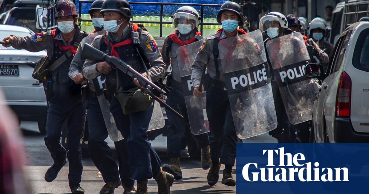Myanmar police fire teargas and rubber bullets in violent crackdown on protesters – video
