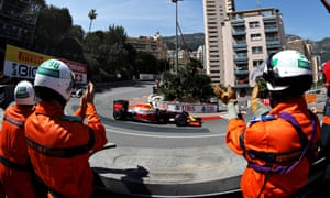 Marshals applaud Daniel Ricciardo on his slowdown lap after he claimed pole position for Red Bull in qualifying for the Monaco F1 Grand Prix