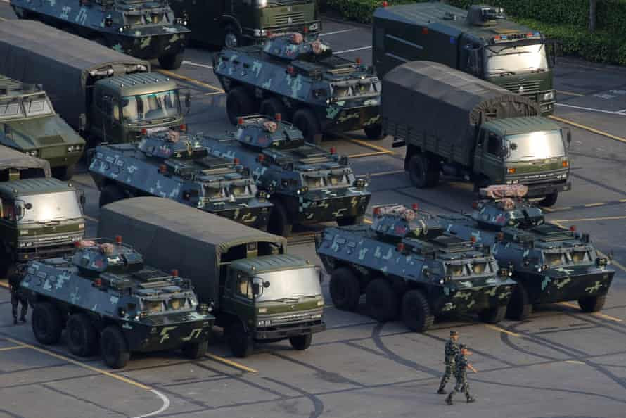 Military vehicles parked on the grounds of the Shenzhen Bay sports centre.