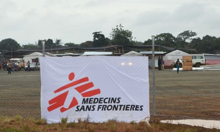 A Médecins Sans Frontières banner is seen on the fence of a hospital in Monrovia