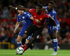 Manchester United's Paul Pogba is held by Wilfred Ndidi of Leicester City. Pogba scored from the sport early on, helping United to their 2-1 win in the opening games of the season at Old Trafford.