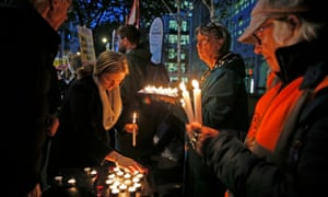 People attend a vigil outside the Home Office in Westminster for the 39 Chinese people found dead inside a lorry.