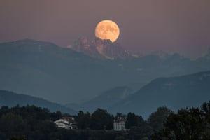 Alps, France: A near full moon rises behind the French Alps, as seen from Geneva