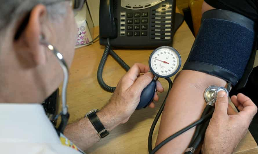 GP checking bloody pressure
