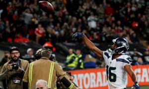 Seattle Seahawks' Tyler Lockett celebrates a touchdown.