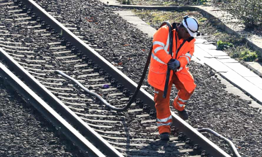 a worker on the rail line