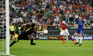 Chelsea's Cesar Azpilicueta shoots at goal as Arsenal's Petr Cech attempts to save and Ainsley Maitland-Niles looks on.