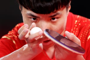 Chinese table tennis player Chao Chen prepares to serve.