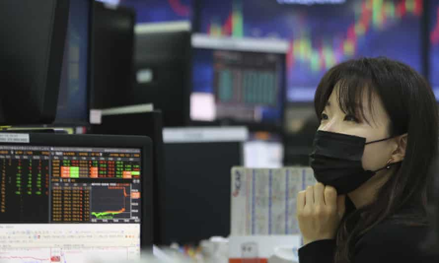 A currency trader wearing a mask