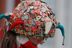 A fan with her hat covered in badges.