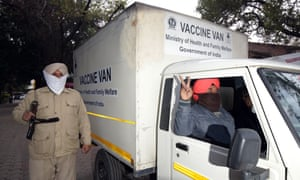 The driver of a van containing Covid-19 vaccines from the Serum Institute of India flashes a victory sign as the vaccine boxes arrive in Amritsar.